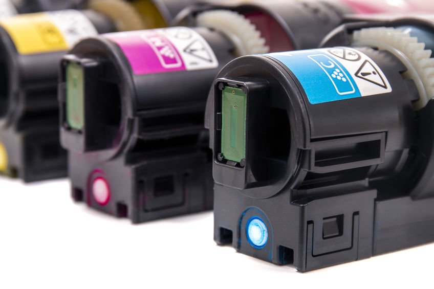 cartridges for laser printers aligned on a white background.